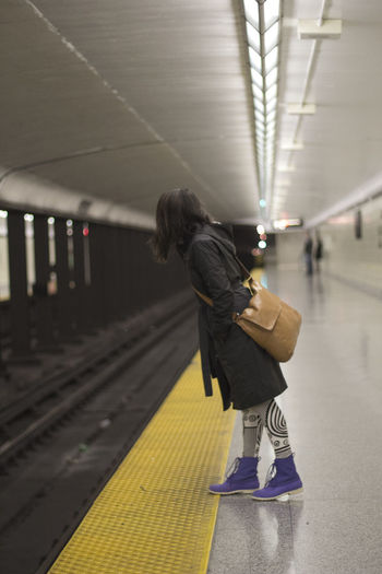 Black Coat Canada Colourful Commuter Commuting Girl Girl Waiting Looking To The Other Side On The Train On The Way Short Depth Of Field Subway Subway Station Toronto Train Train Station Underground Underground Station  Unrecognizable Person Waiting Waiting For A Train