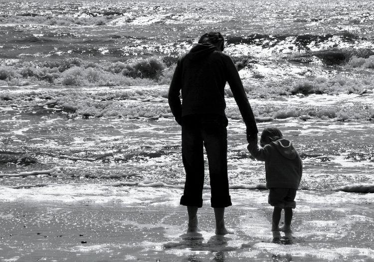 Full length rear view of children at beach