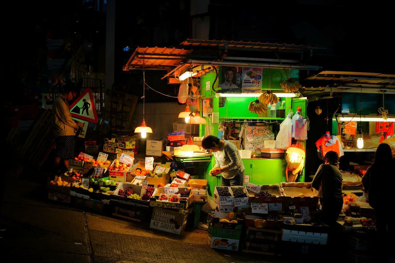 real people, night, retail, market stall, for sale, market, choice, men, illuminated, variation, store, occupation, women, lifestyles, food, large group of people, outdoors, supermarket, people