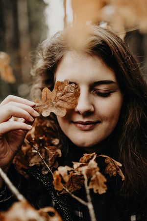 We live, wo love, we die. Leaf Nature One Person Real People Headshot Leisure Activity Front View Focus On Foreground Holding Human Face Close-up Young Women