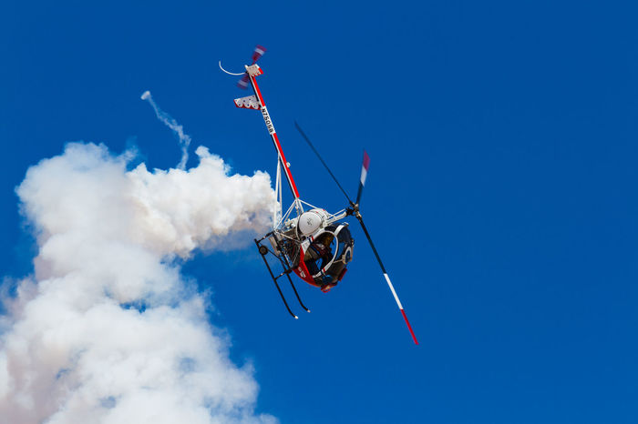 Flying Display Helicopter Smoke Blue Flying Manouver Sky White And Blue