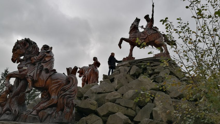 Wood - Material Art Statue Climbing Tree Horse Sky Cloud - Sky Sculpture Human Representation Carving - Craft Product