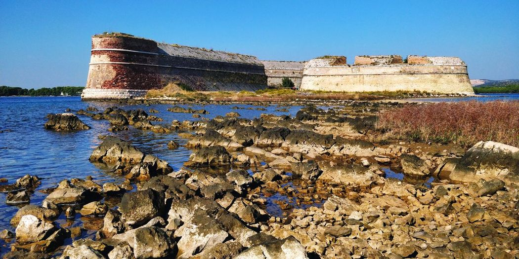 Castle EyeEm Selects Water Beach Sea Sand Blue Sky Historic Fort Fortress Past History Medieval Fortified Wall Building