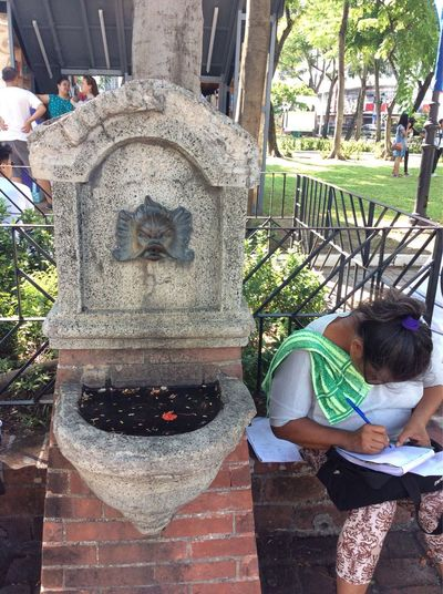 What are you writing? Fountain Brass Fat Lady Writing Manila ManilaStreetPhotography Intramuros Intramuros| Philippines