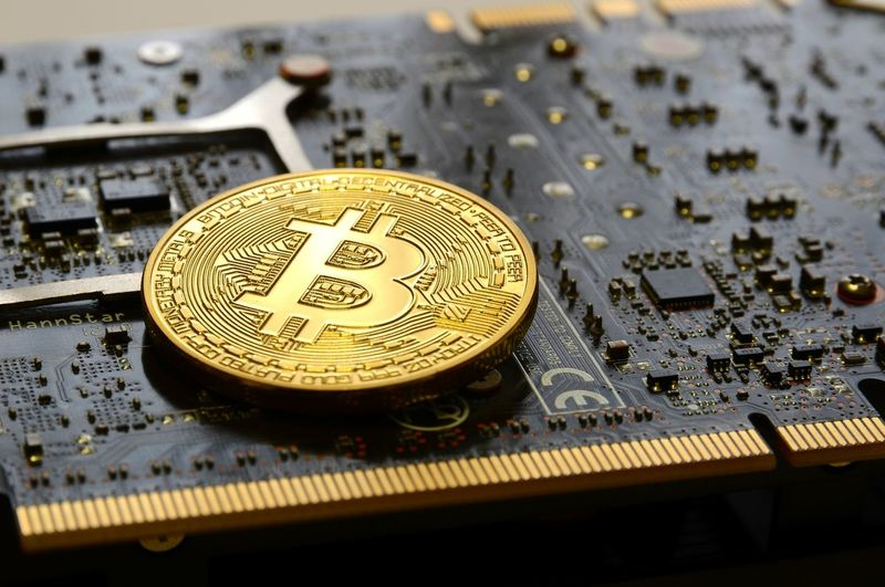 Close-up of bitcoins on computer equipment