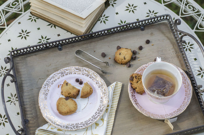Tea and biscuits Afternoon Tea Beverage Biscuits Book Chocolate Chip Cookies Cup Of Tea..  Food Photography Morning Tea Tea Bag Tea Time Tongs Tray