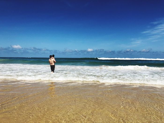 Blue Wave Daughter Father Water Sea Beach Land One Person Real People Sky Beauty In Nature Lifestyles Horizon Scenics - Nature Horizon Over Water Full Length Leisure Activity Outdoors Standing Nature Tranquility Sand