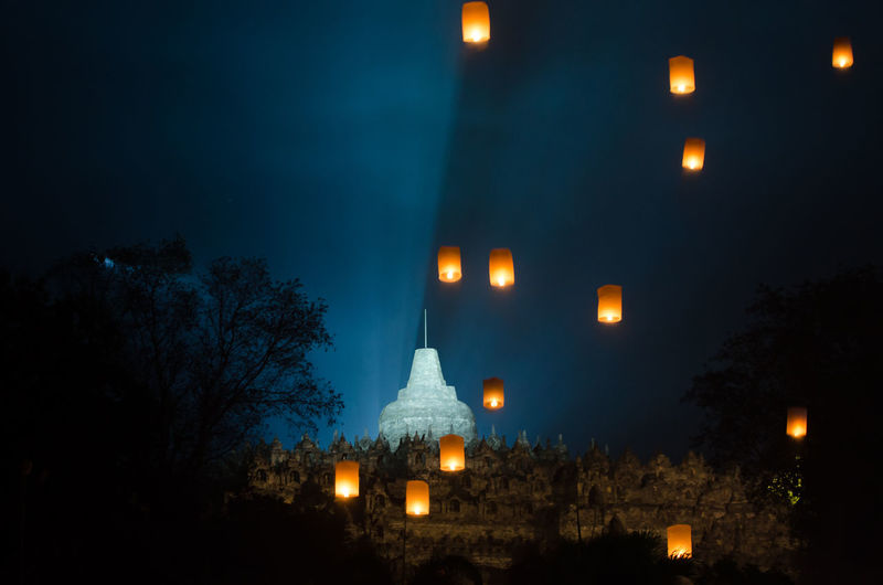 amazing lampion waisak / vesak at borobudur temple, indonesia Architecture Building Building Exterior Built Structure Dusk Electric Lamp Fuel And Power Generation Full Moon Illuminated Lighting Equipment Moon Moonlight Nature Night No People Outdoors Plant Residential District Sky Street Street Light Tree