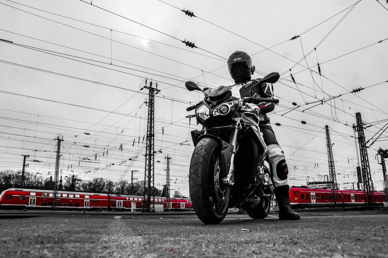 transportation, mode of transportation, sky, real people, land vehicle, cable, full length, day, technology, people, rail transportation, electricity, travel, nature, helmet, men, railroad track, track, connection, power supply, riding, outdoors, crash helmet
