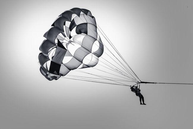 Parasailing in Bangladesh Bangladesh Cox's Bazar Coxsbazar Flying Fun Gray Background Mid-air Outdoors Parachute Parasailing Sport