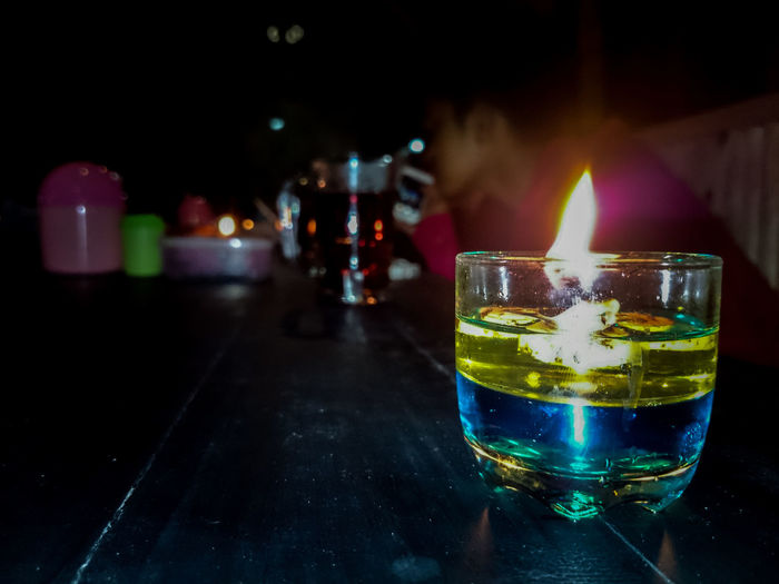 Close-up of fire in drink on table at bar