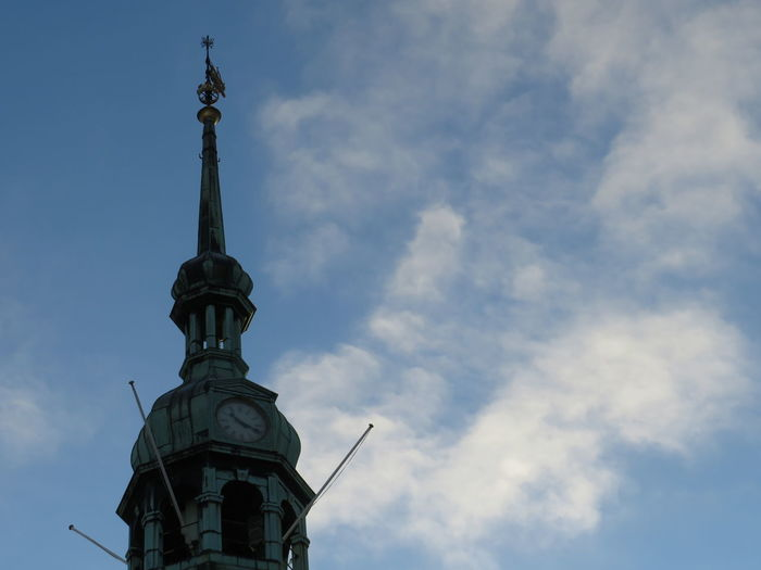 Low angle view of statue of tower against cloudy sky