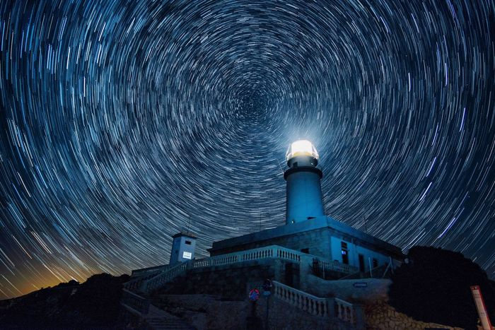 Faro de formentor. Illuminated Night Architecture Building Exterior Built Structure Sky No People Glowing Tourism Lighting Equipment Outdoors Travel Destinations Building City Beauty In Nature Blue Low Angle View Nature Tower Water