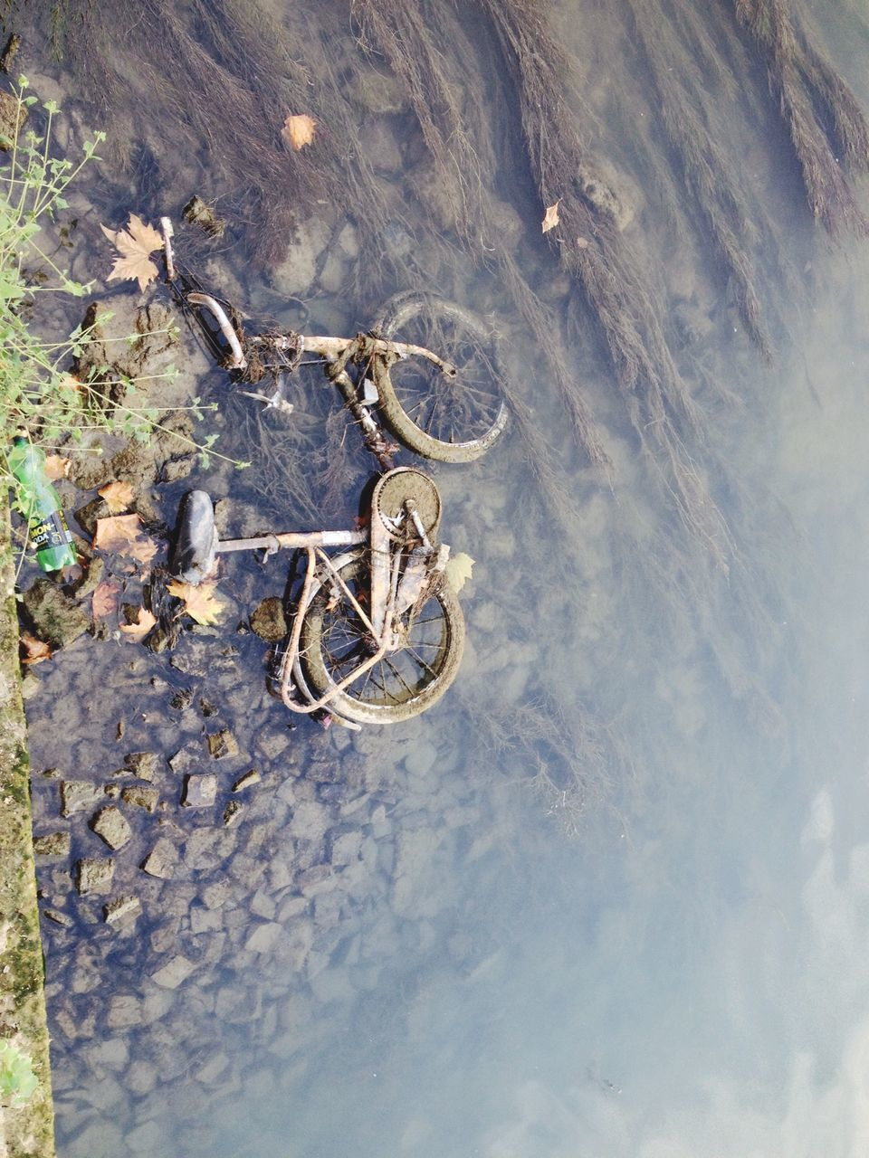 High Angle View Of Abandoned Old Bicycle In Water