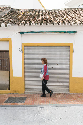 Marbella MarbellaOldTown Old Town SPAIN Architecture Spanish Architecture Holiday Destination Vibrant Color Real People Built Structure Building Exterior One Person Full Length Building Day Young Adult Leisure Activity Women Mid Adult Women Adult Casual Clothing Females Beautiful Woman Walking Strideby
