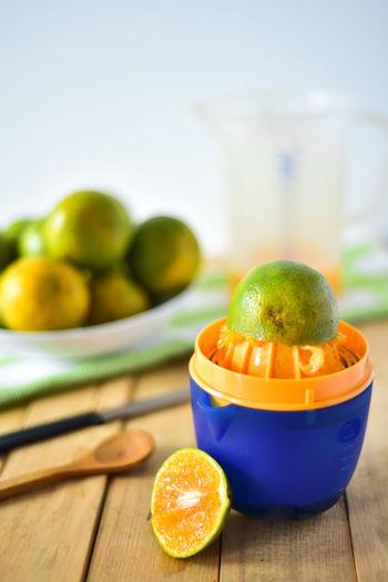 Close-up of orange and juicer