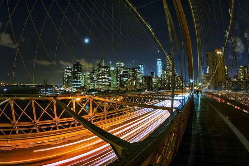 Illuminated Light Trails On Brooklyn Bridge At Night