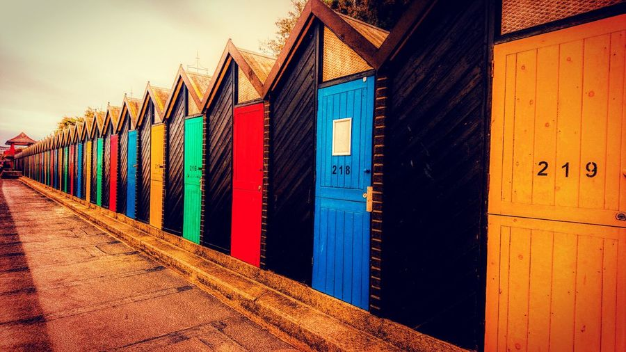 Multi Colored No People Built Structure Outdoors Sky Beachphotography Beach Beachhut Beachhuts Beachcabins Colours Huts Row Row Of Beach Huts Mobilephotography Me, My Camera And I Outdoorphotography Outdoor Colourful