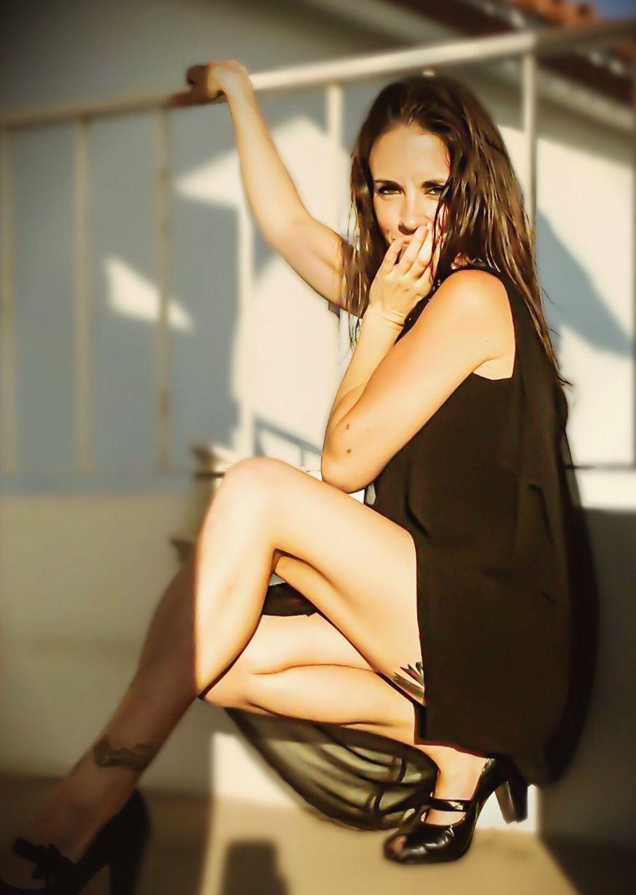 Portrait Of Beautiful Woman Wearing Black Dress
