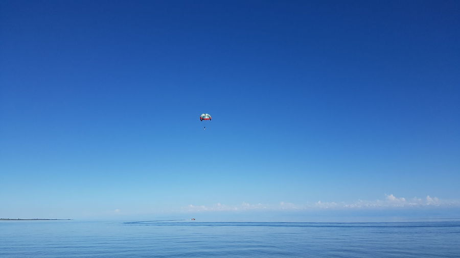 Beach Blue Clear Sky Flying Horizon Over Water Outdoors Parachute Paragliding Sea Sky Tranquil Scene Water Waterfront