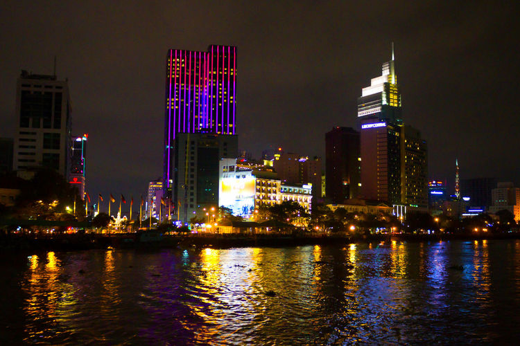 Architecture Building Exterior At Night In Vietnam. Vietnam Architecture Building Building Exterior Built Structure City Cityscape Financial District  Illuminated Modern Nature Night Nightlife No People Office Building Exterior Outdoors Reflection River Sky Skyscraper Tall - High Tower Urban Skyline Water Waterfront