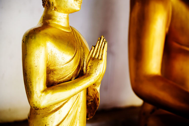 Close up hand of Golden buddha statue in the temple Thai Thailand Ancient Antique Art ASIA Asian  Belief Buddha Buddhism Buddhist Close Up Culture Faith Gold Golden Hand Image Karma Meditation Mind  Namaste Peace Peaceful Religion Respect Sculpture Spirit Statue Symbol Temple Worship