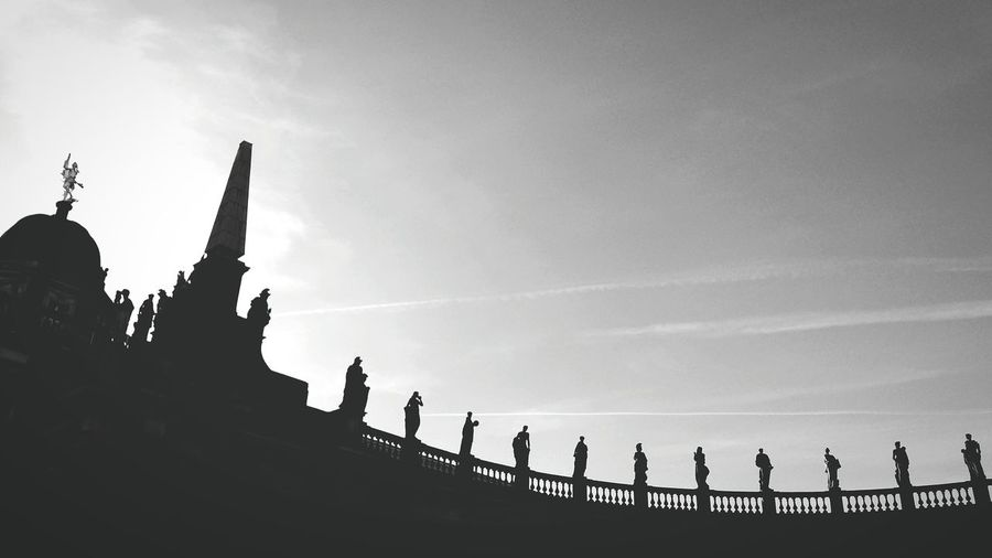 Silhouette Statues On Building At St Peter Square Against Sky