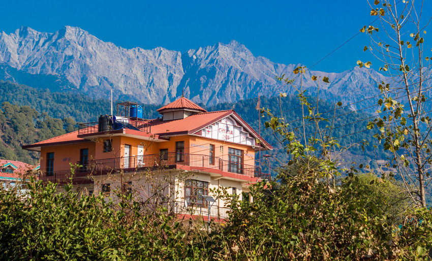 Houses against mountains and blue sky