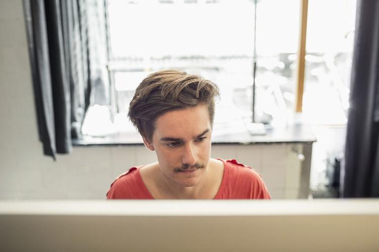 Portrait of senior man sitting at window