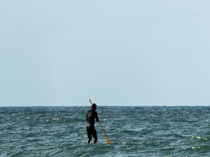 Paddleboarding EyeEm Gallery EyeEmBestPics Clear Sky Copy Space Day Full Length Holding Horizon Horizon Over Water Leisure Activity Lifestyles Men Minimal Minimalism Ocean One Person Outdoors Paddling Real People Scenics - Nature Sea Sky Unrecognizable Person Water Wetsuit