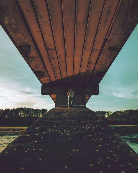 Bridged Architecture Bridge Bridge - Man Made Structure Building Exterior Built Structure Cloud - Sky Connection Day Leisure Activity Lifestyles Metal Nature One Person Outdoors Real People Rear View Sky Transportation Underneath Water
