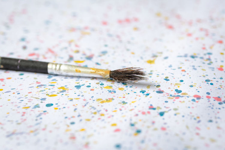 Children Colors Kids Paint Brush Brushes Celebration Close-up Colorful Confetti Day Education Educational Focus On Foreground High Angle View Nature Paintbrush Selective Focus Single Object Splash Studying Table White Background White Color Writing Instrument