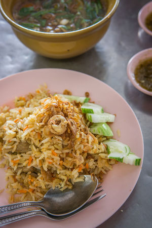 biryani rice on the table Biryani Rice Chicken Close-up Cucumber Curry Day Food Food And Drink High Angle View Indoors  No People Plate Rice Spoon And Fork Table Yellow