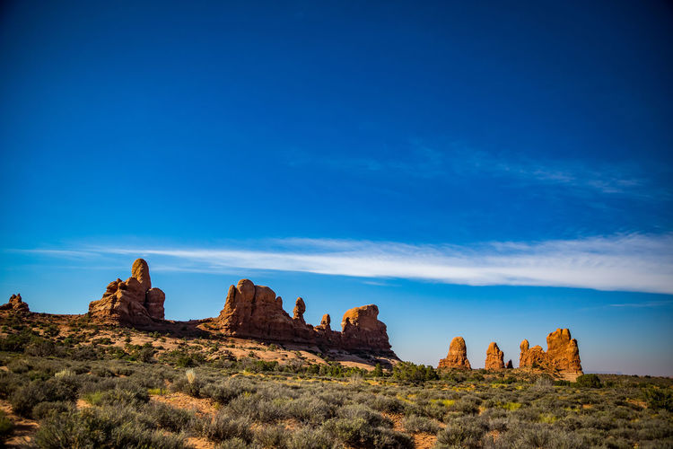 Rock formations against blue sky