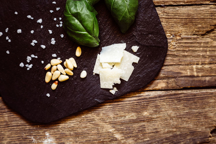 Food And Drink Food Freshness Table Wood - Material Healthy Eating Still Life Indoors  Vegetable Close-up Wellbeing High Angle View No People Directly Above Cutting Board Ready-to-eat Indulgence Plant Part Leaf Temptation Pine Nut Chopped