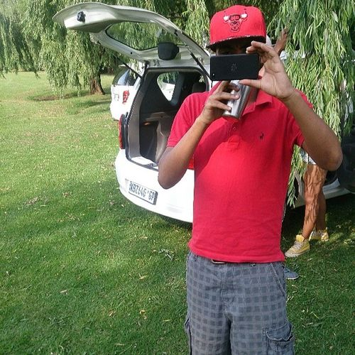 This schmuck takes a picture of me while I'm taking a picture of them!!! Kwa !! Polo Nike Chicago Bulls