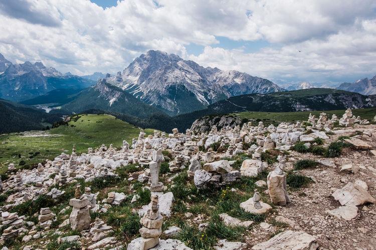 Scenic view of mountains against sky while hiking tre crime di lavaredo