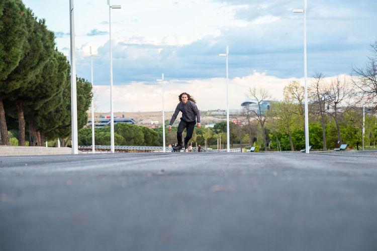Full length of man on road against sky