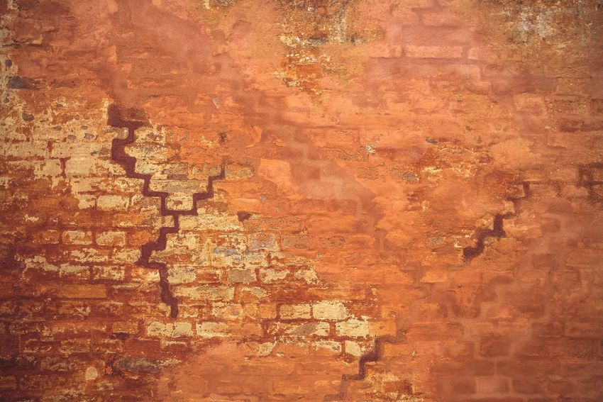 Rustic brick wall with orange paint in a grunge look Grunge Paint Backgrounds Full Frame No People Pattern Textured  Metal Close-up High Angle View Weathered Orange Color Decline Abstract Brown Old Day Nature Deterioration Outdoors Rusty Rough