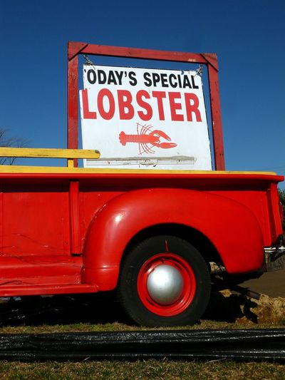 ODAY'S LOBSTER SPECIAL LOBSTER TRUCK MOON HUB CAPS RED FENDERS RED TRUCK WITH LOBSTER SIGN RED TRUCK WITH SIGN Clear Sky Day Outdoors Red Sky Transportation