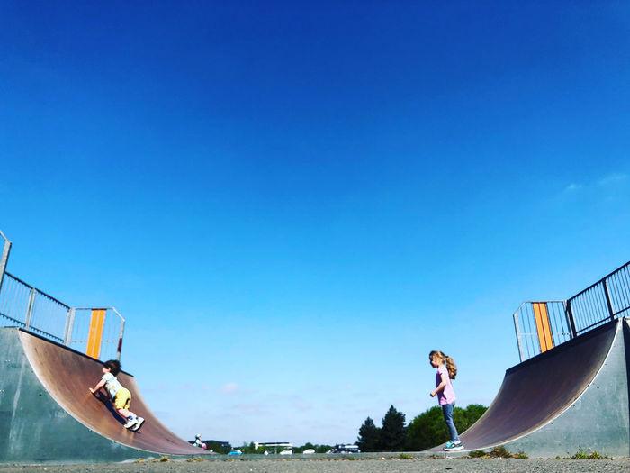 Siblings at skateboard park
