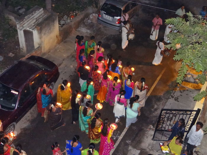 BEGINNING OF LIGHTS FESTIVAL IN THE STREET Street View Ready To Move To Temple Holding Oil Lamps Traditional Festival Devotees Band Party Lights Festival Crowd Women Men Group Of People High Angle View A New Beginning Capture Tomorrow