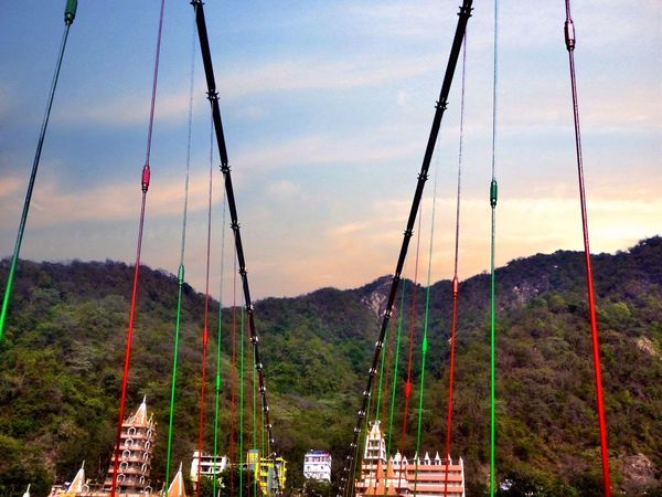Lakshman Jhula(लक्ष्मण झूला) is an ironsuspension bridgesituated inTapovanin the boundary ofNew Tehridistrict of theIndianstate ofUttarakhand. It was erected over theGangesriver and is a landmark of Rishikesh.Hrishikesh LaxmanJhula Uttrakhand Temple Architecture Bridge - Man Made Structure Bridge View Bridgescape Sunset Outdoors Cloud - Sky Beauty In Nature Nature Swing Day Adapted To The City EyeEmNewHere The Great Outdoors - 2017 EyeEm Awards Neighborhood Map India EyeEm Selects
