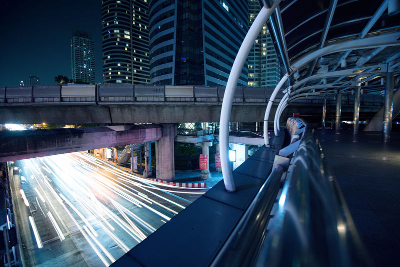 Transportation Architecture Built Structure Illuminated City Motion Building Exterior Night Connection Speed Long Exposure Mode Of Transportation Light Trail Blurred Motion Modern Bridge Bridge - Man Made Structure Building City Life Office Building Exterior Outdoors Skyscraper