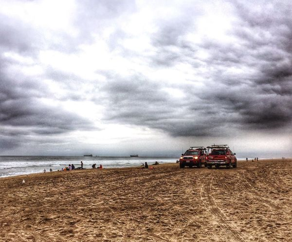 Lifeguards at the beach just before a downpour. Taking Photos Traveling Travel Photography Hanging Out Outdoor Photography Outdoors Travelphotography Landscape Ocean Travel Destinations Sand California Weather Nature Photography Land Vehicle Landscapes Clouds Clouds And Sky Rainy Days