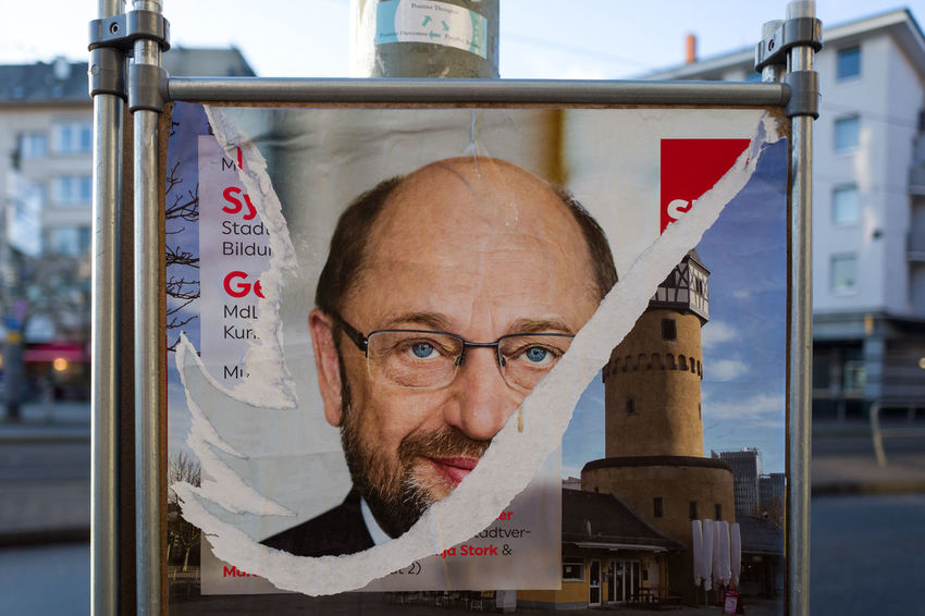 Torn poster of German SPD politician Martin Schulz in Frankfurt, Germany Martin Politics Poster Schulz Adults Only Architecture Building Exterior Close-up Day Focus On Foreground Front View Headshot Looking At Camera Mature Adult Mature Men One Person Outdoors People Portrait Real People Spd Torn