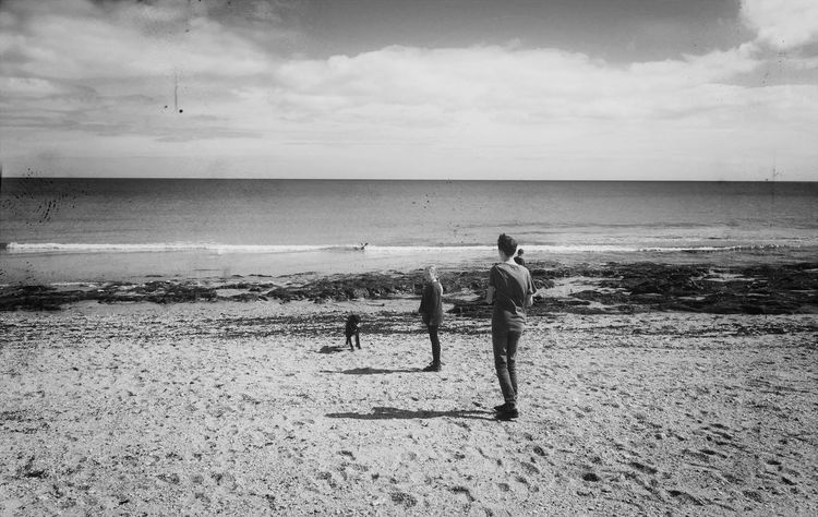 Portscatho Cornwall Towan Beach Sea Beach Real People Water Horizon Over Water Nature Sky Sand Shore Men Leisure Activity Standing Togetherness Scenics Cloud - Sky Beauty In Nature Shadows Outdoors Day Childhood Bnw_collection Black & White Live For The Story