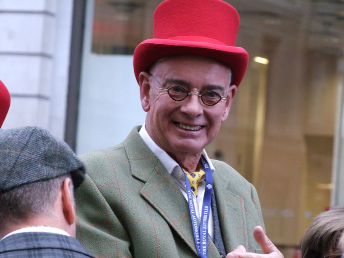 Contestant in London to Brighton Vintage Car Rally Capital City Contestant Costume Fun Funny Funny Face GB Glasses Happy Headshot London London To Brighton Vintage Car Rally Looking At Camera Man Mature Adult Mature Man Motorist No People Portrait Rally Red Hat Smiling Uk