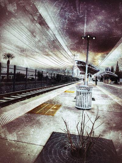 Empty railroad station platform against sky