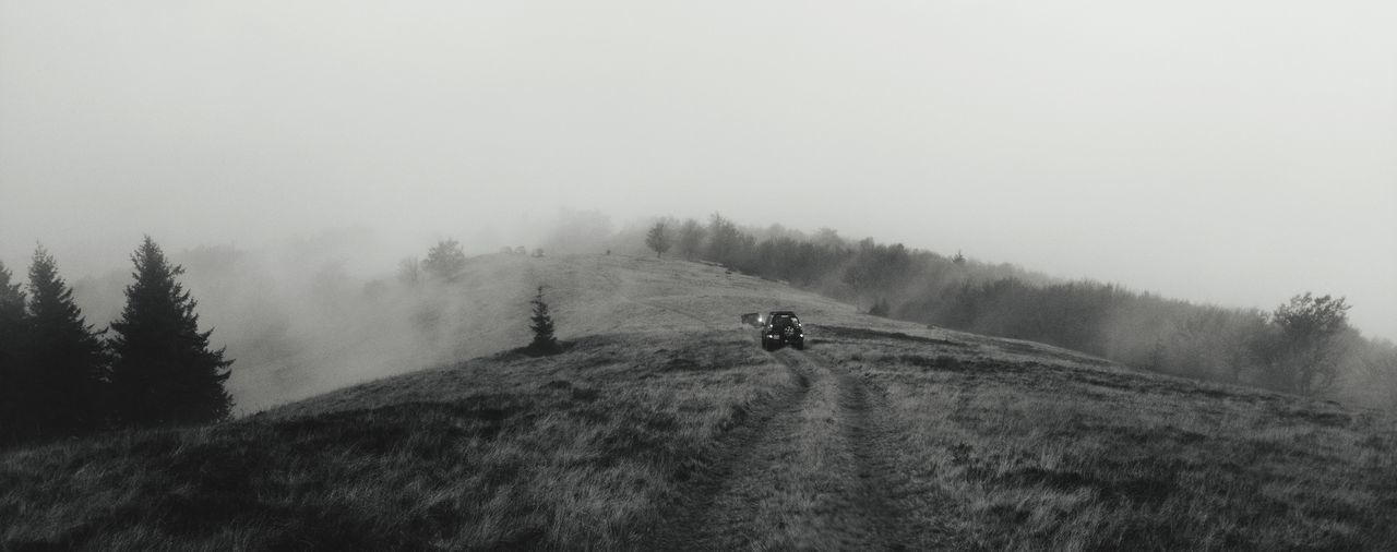 Off-Road Vehicle On Field Against Sky